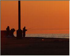Fisherman at sunrise - Copyright © 2007 by Melagoo
